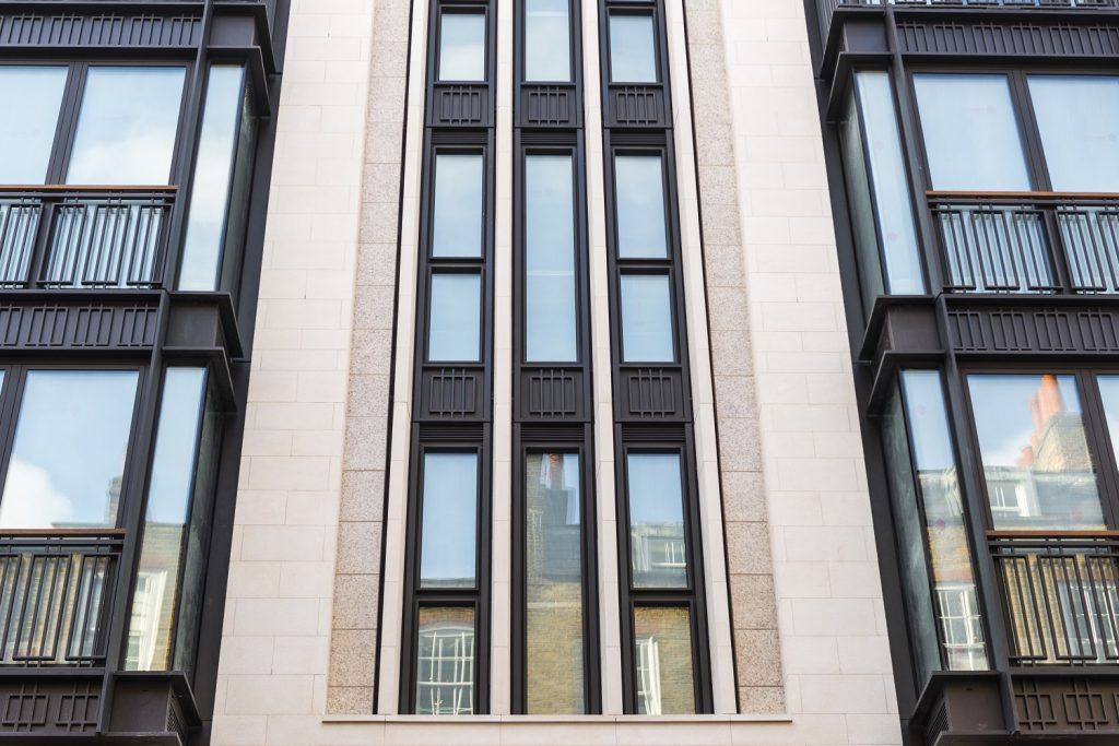 Limestone exterior covering of a building in Carey Street in London, UK supplied by LSI Stone