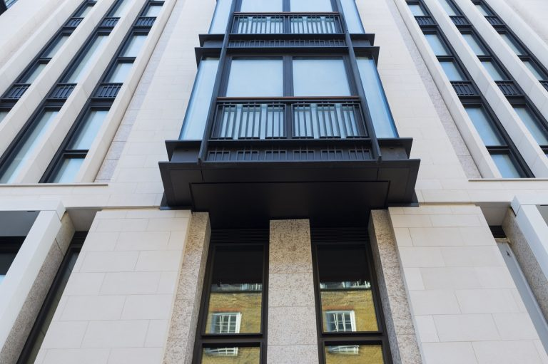 Limestone facade of a building in Carey Street in London, UK supplied by LSI Stone